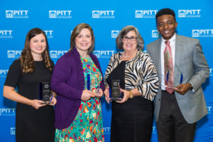 During a reception on campus Oct. 10, the PCC Alumni Association presented awards to Jessica Yelverton, Jennifer Smith, Lisa Owens and La'Quon Rogers, left to right, for their accomplishments professionally, in the community and in service to the college.