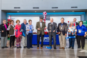 PCC Foundation Board members and college administrators were all smiles as they cut the ribbon to officially open the 2017 Down East Holiday Show.
