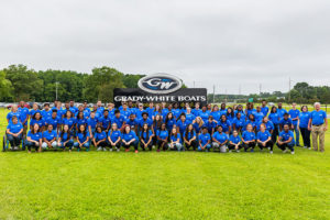 2018 visions class posing on the grass