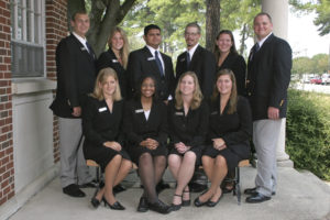 group of students all in black suits 2007