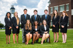 group of students all in black suits 2015