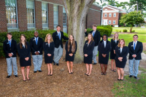 group of students all in black suits 2016