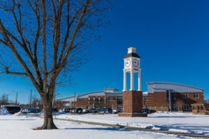 campus clock tower in the snow