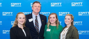 Photo of Scholarship donor with three student scholarship recipients.