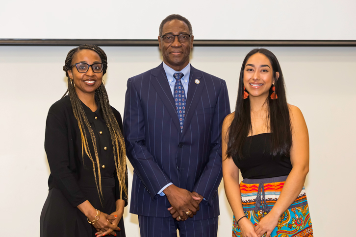 Following Pitt's annual celebration of Dr. Martin Luther King Jr.'s fight for civil rights Thursday morning, President Lawrence Rouse congratulated recipients of this year's PCC Multicultural Activities Committee scholarships, Sharon Moore (left) and Jennifer Santos.