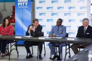Gov. Roy Cooper listens to PCC President Lawrence Rouse speak during a roundtable discussion of the state's Finish Line Grants program.