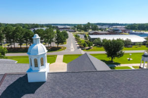 Aerial view of campus with the Warren Building cupola in the foreground.