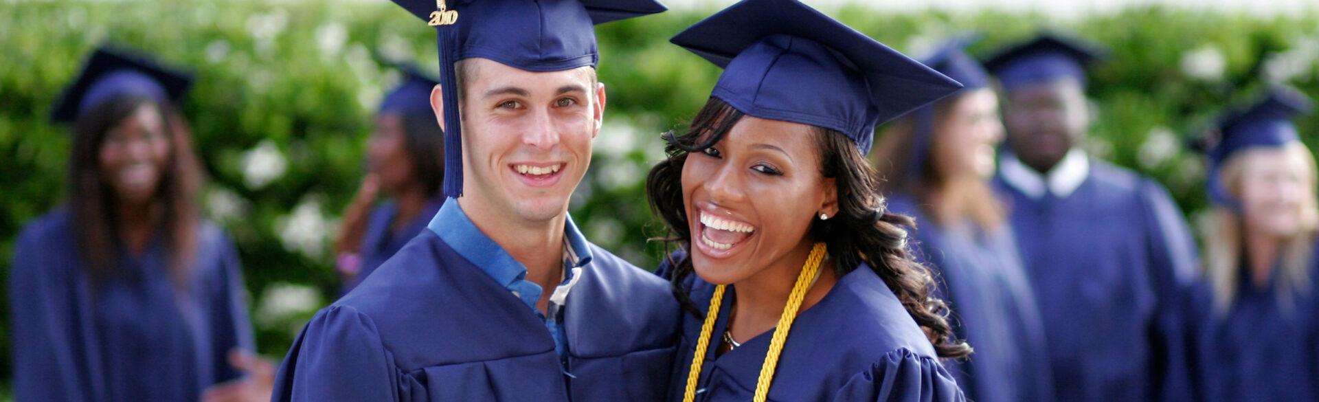 Photo of two smiling PCC graduates.