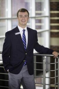 Portrait of Dylan Evans in Student Ambassador uniform.