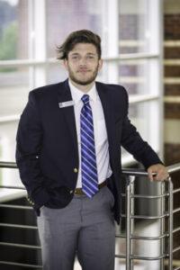 Portrait of Geromy Wright in Student Ambassador uniform.