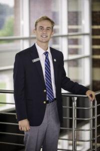 Portrait of Joshua Furlough in Student Ambassador uniform.