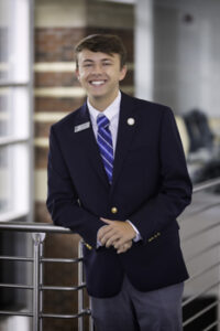 Portrait of Joshua Rogister in Student Ambassador uniform.