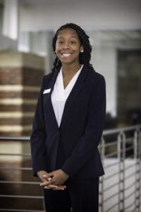 Portrait of Krystan Simpson in Student Ambassador uniform.