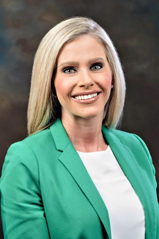 Portrait of Brooke Worthington in green jacket and white shirt.