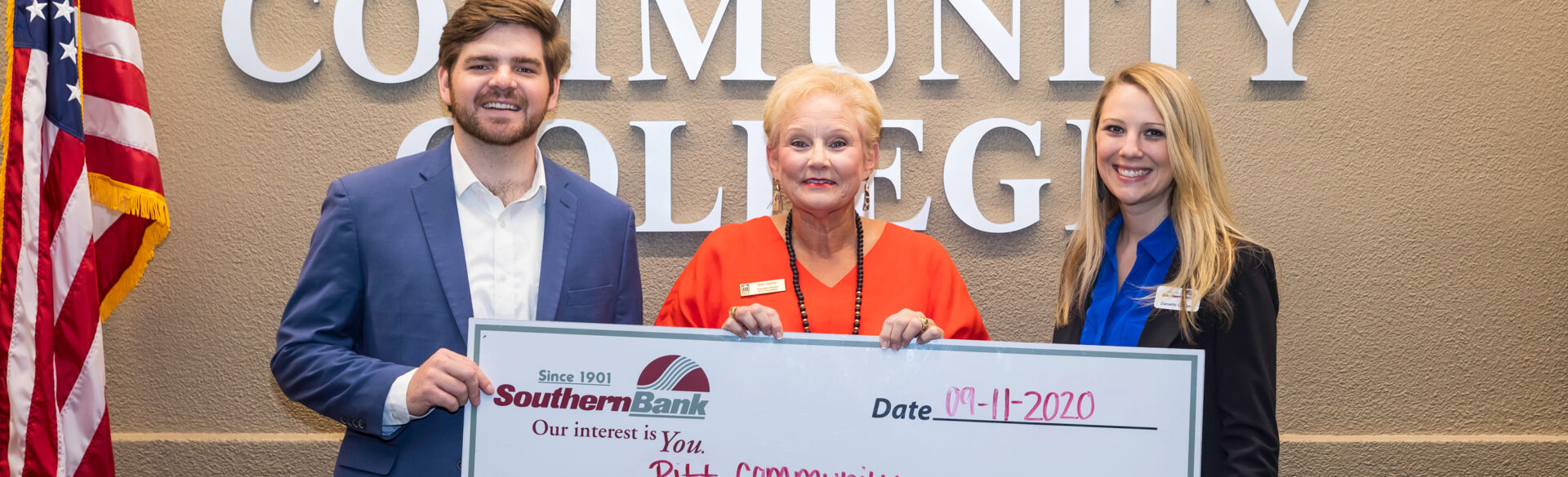 Southern Bank's Austin Parker (left) and Danielle Cooper (right) present a $25,000-check to PCC Foundation Executive Director Beth Sigmon during a Sept. 11 visit to the Pitt campus.