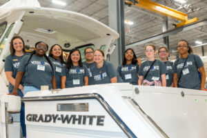 VISIONS students and staff take time out for a group photo on a Grady-White boat, during a tour of the Greenville boat manufacturing facility.
