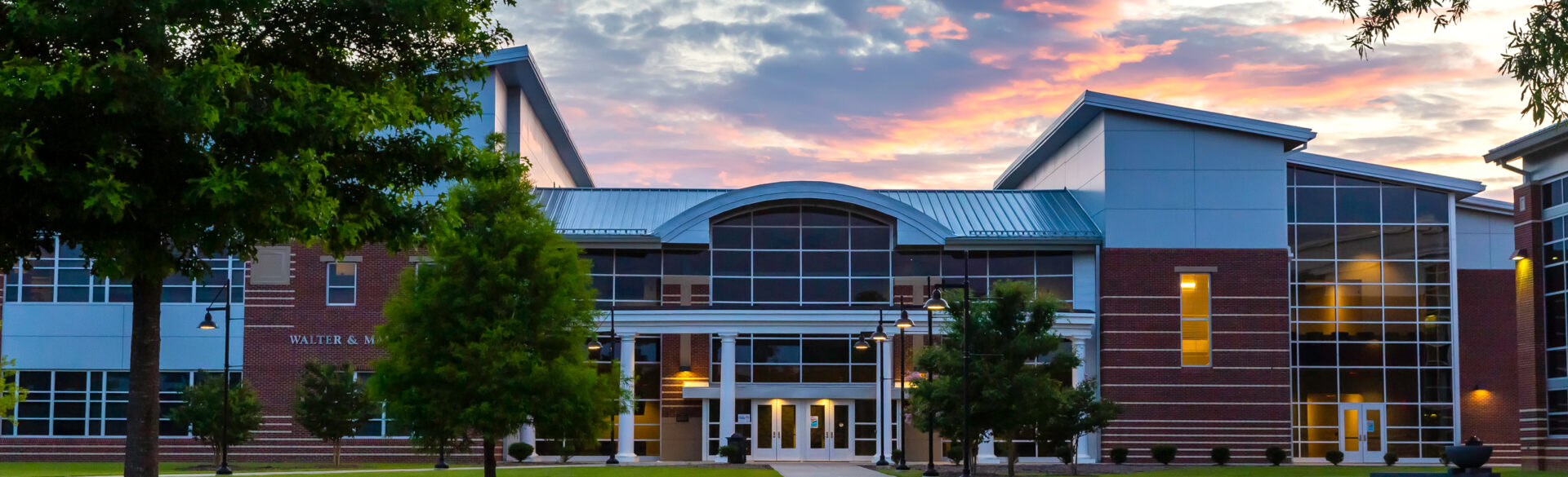 Walter and Marie Williams Building at dusk.