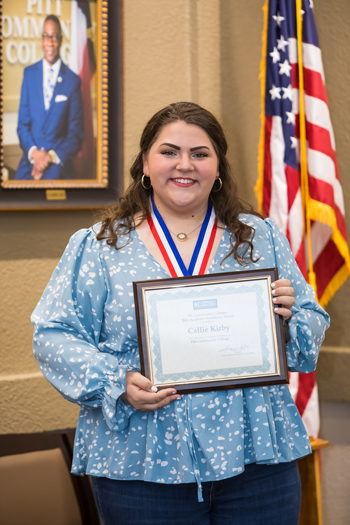 Callie Kirby displays a certificate she received for being PCC's recipient of the N.C. Academic Excellence Award.