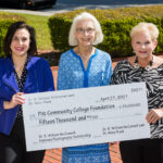 Dr. Mary Raab, center, presents a $15,000-check to the PCC Foundation to initiate the creation of the Dr. R. William McConnell Endowed Radiography Scholarship. Accepting on the foundation's behalf are PCC Scholarships Coordinator Kim Simpkins, left, and PCC Foundation Executive Director Beth Sigmon.