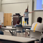 VISIONS HS Coordinator Katelynn Speas leads presentation for students participating in the 2021 Summer Institute.