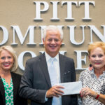 First Citizens Bank's Gordon Jethro presents the final installment of a $50,000-contribution his company made in support of the PCC Foundation's capital campaign. Accepting on the foundation's behalf are PCC Vice President of Institutional Advancement Marianne Cox, left, and PCC Foundation Executive Director Beth Sigmon.