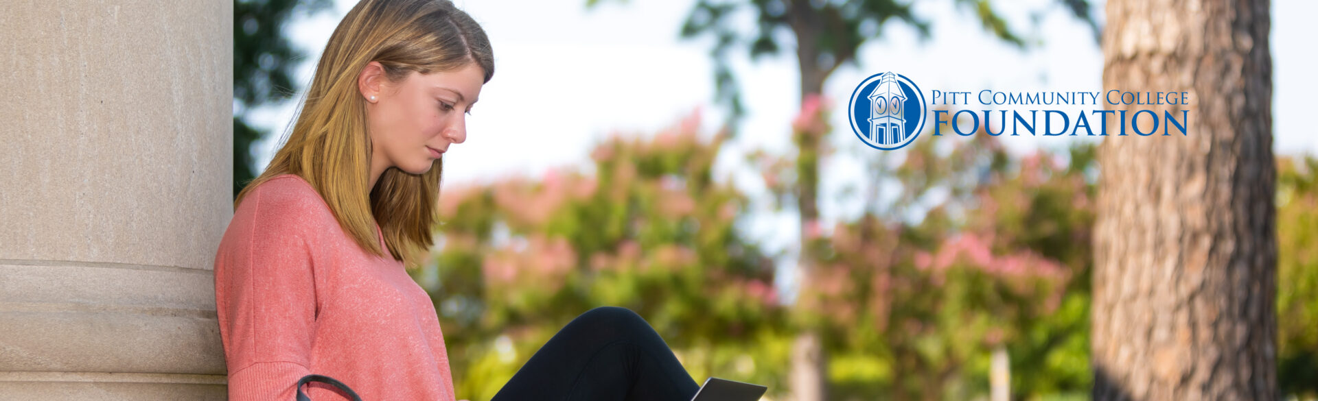 Student studying on Humber Building steps.