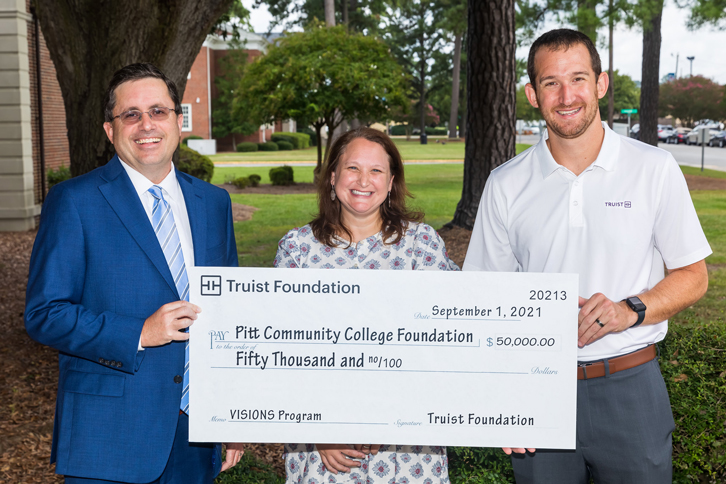 On the Truist Foundation's behalf, Truist Market President Jon Anderson, right, presents a $50,000-check to PCC Development Officer John Bacon and PCC VISIONS Director Rebecca Warren in support of the college's VISIONS Career Development and Scholarship Program.